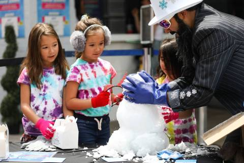 Marco Villarreal, known as ÒVegas Ice Man,Ó helps his daughters Mabel Villarreal, 7, ...