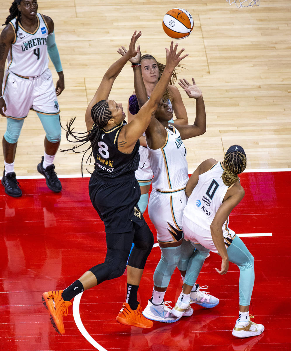 Las Vegas Aces center Liz Cambage (8) gets off a second shot for a score over New York Liberty ...