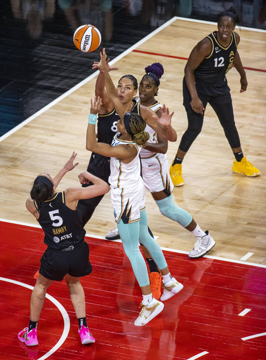 Las Vegas Aces center Liz Cambage (8) blocks a shot by New York Liberty forward Leaonna Odom (0 ...