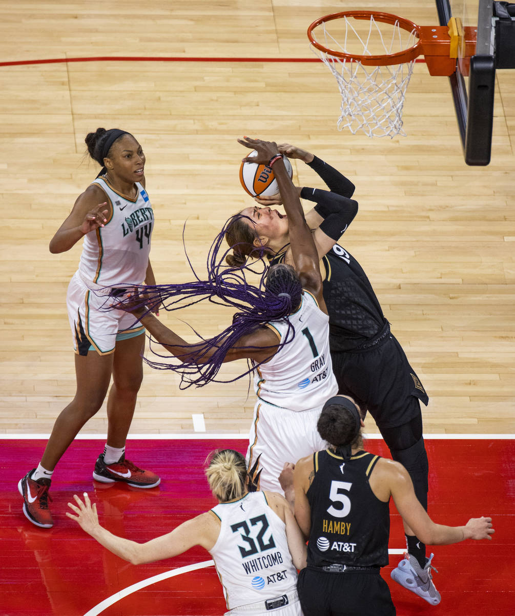 Las Vegas Aces center JiSu Park (19) gets off a shot while fouled by New York Liberty forward R ...
