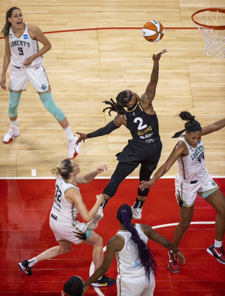Las Vegas Aces guard Riquna Williams (2) jumps for a finger roll over New York Liberty guard Sa ...