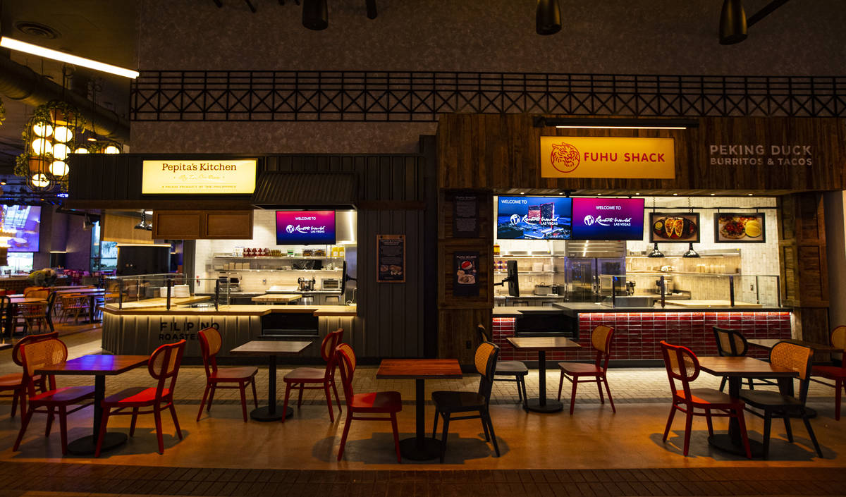 Pepita's Kitchen, left, and Fuhu Shack are seen at the Famous Foods Street Eats area during a t ...
