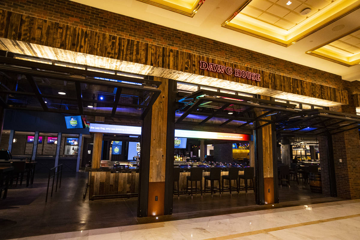 A view of one of the bars with the garage-style doors open at Dawg House Saloon & Sportsbook du ...