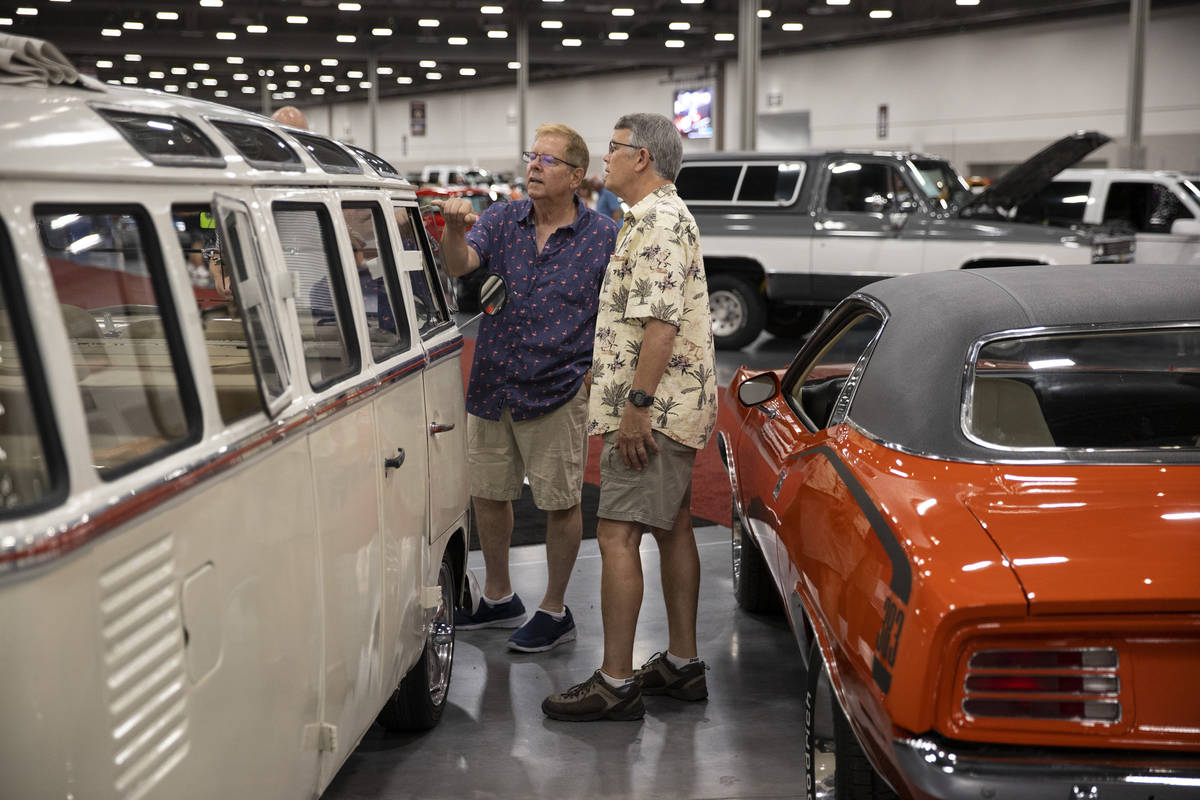 Jeff Gordon, left, and Frank Nunez, of Los Angeles, check out a 1964 Volkswagen microbus while ...