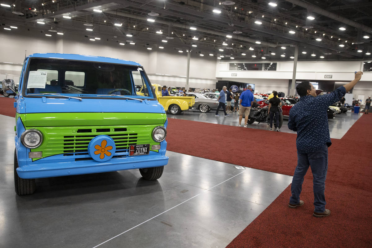 """Alexander Vivas of Clombia takes a photo with the 1968 For Ecoline """"Mystery Machine"""" ..."""