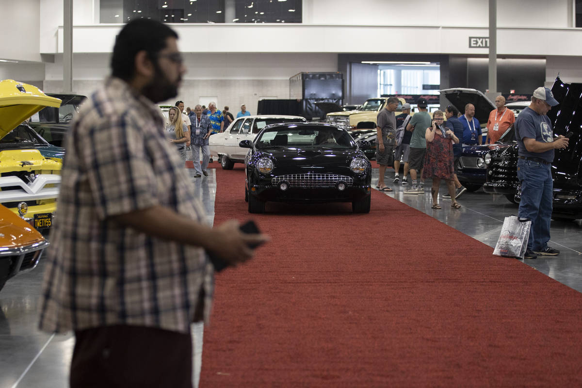 A 2002 Ford Thunderbird convertible is driven in the showroom floor of the Barrett-Jackson auct ...