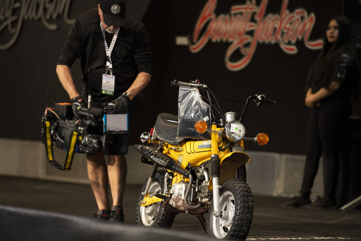 A Honda Trail 70 mini bike is auctioned off in the Barrett-Jackson auction at the Las Vegas Con ...