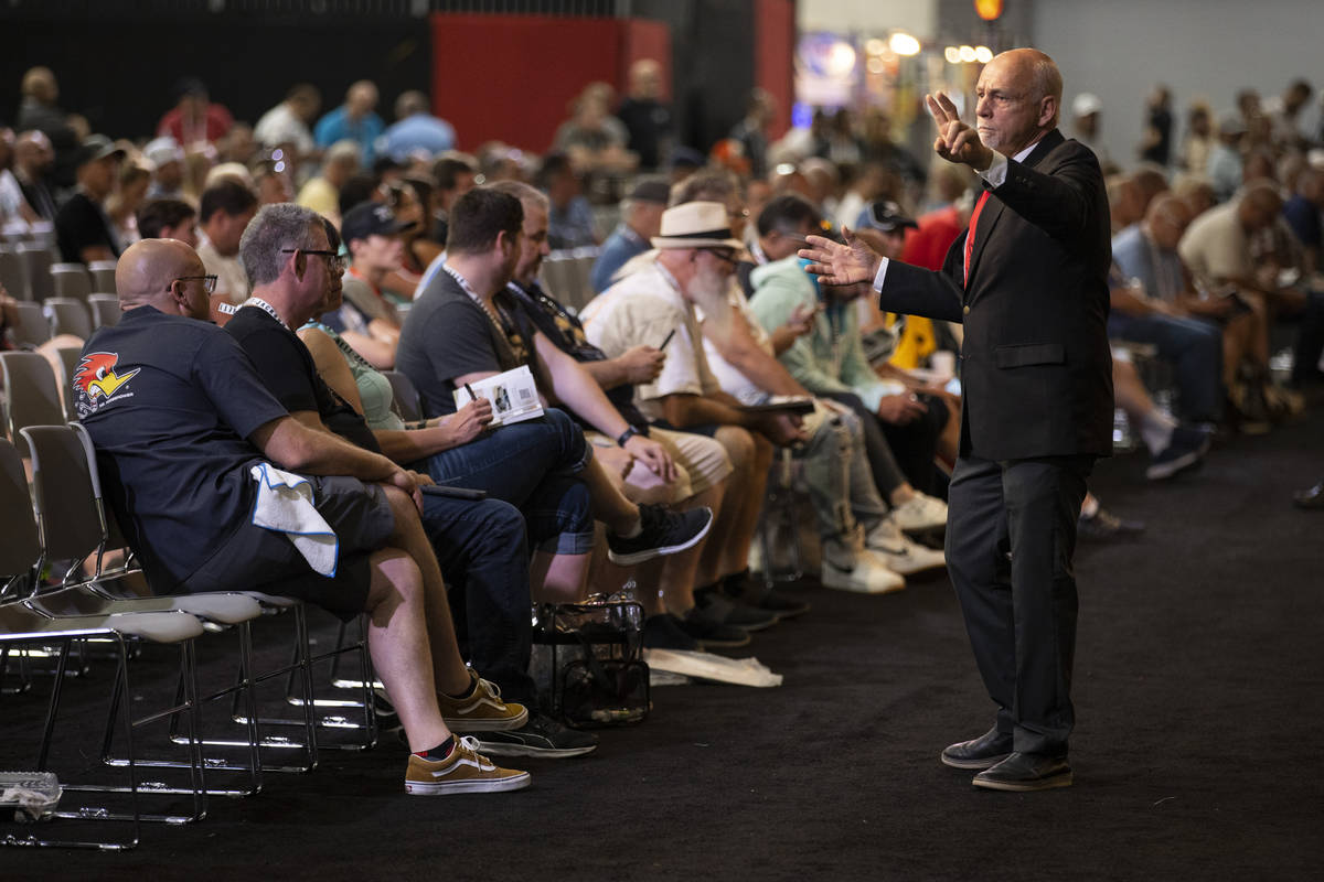 A bidding assistant takes a bid for a motorcycle in the Barrett-Jackson auction at the Las Vega ...