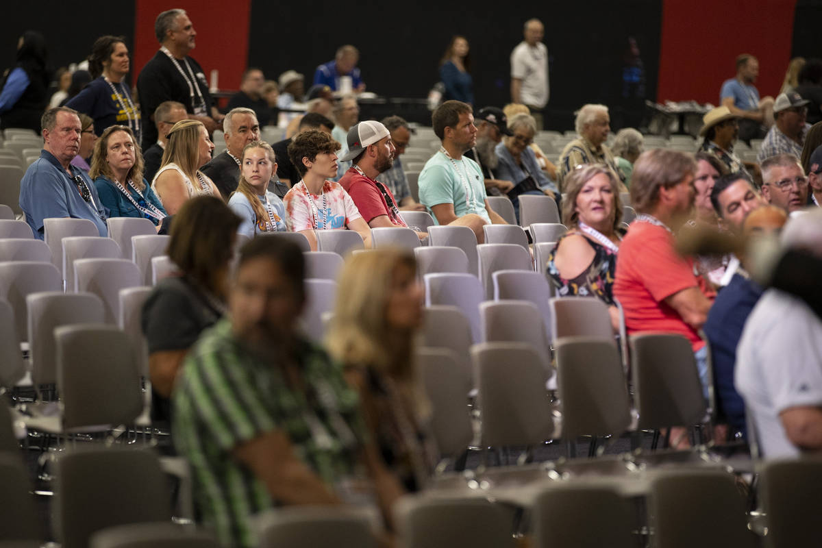 People attend the Barrett-Jackson auction at the Las Vegas Convention Center West Hall in Las V ...