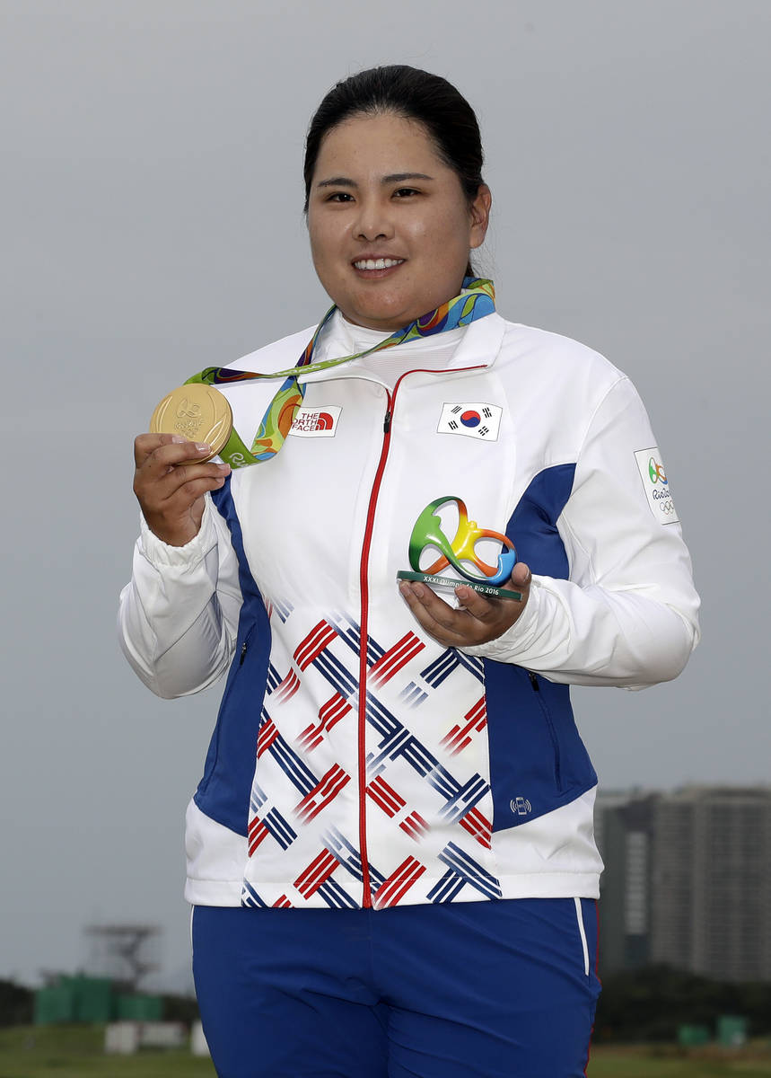 Inbee Park of South Korea, holds up her gold medal after the final round of the women's golf ev ...