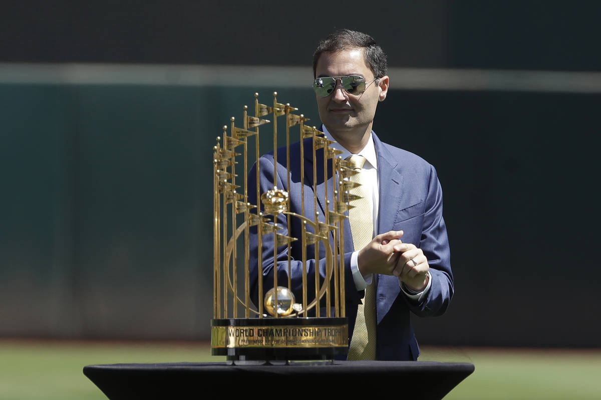 Oakland Athletics President Dave Kaval stands behind the team's 1989 World Series championship ...