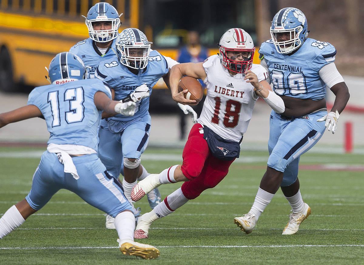 Liberty junior quarterback Daniel Britt (18) cuts up field past Centennial senior Donte Washin ...
