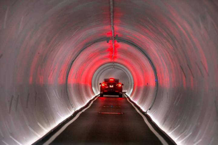 A Tesla is navigated from the West Hall to Central Hall in the Boring Company's Convention Cent ...