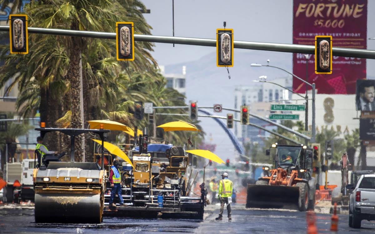Heat waves rise as construction crews pave S. Las Vegas Boulevard near the Peppermill Las Vegas ...