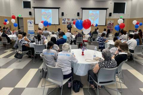 Attendees listen to speeches at the World Refugee Day event hosted by Catholic Charities of Sou ...