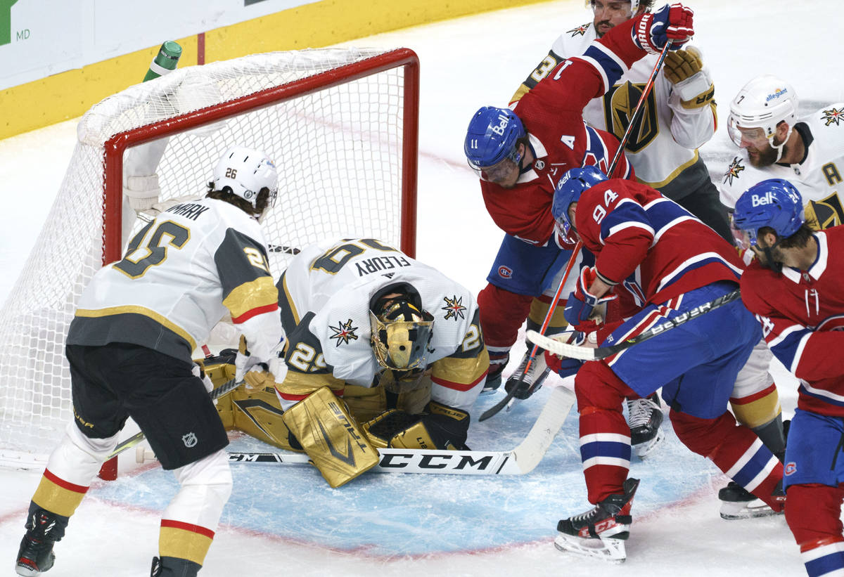 Vegas Golden Knights goaltender Marc-Andre Fleury covers the puck in front of Montreal Canadien ...