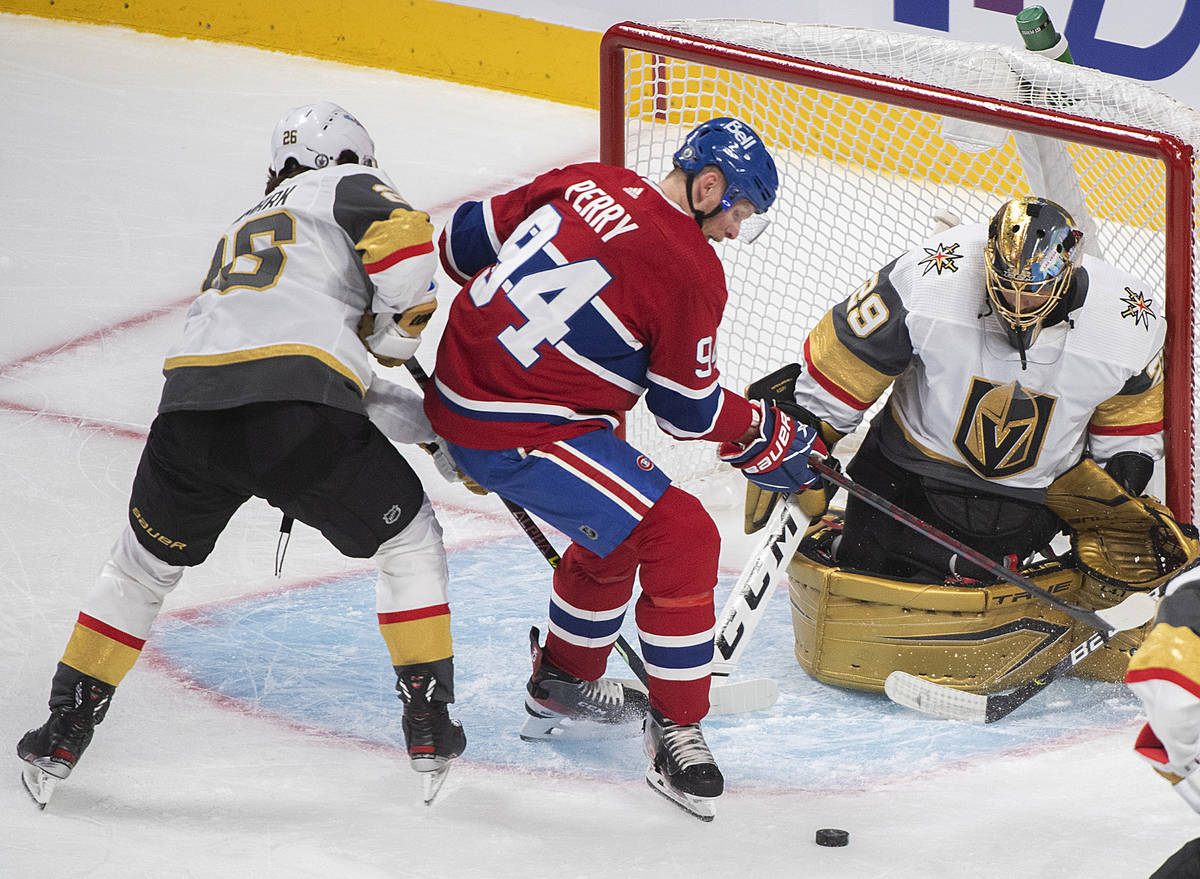 Montreal Canadiens' Corey Perry (94) moves in on Vegas Golden Knights goaltender Marc-Andre Fle ...
