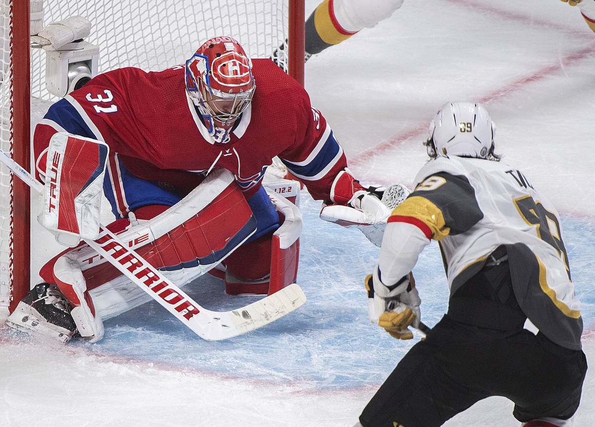 Vegas Golden Knights' Alex Tuch moves in on Montreal Canadiens goaltender Carey Price during th ...