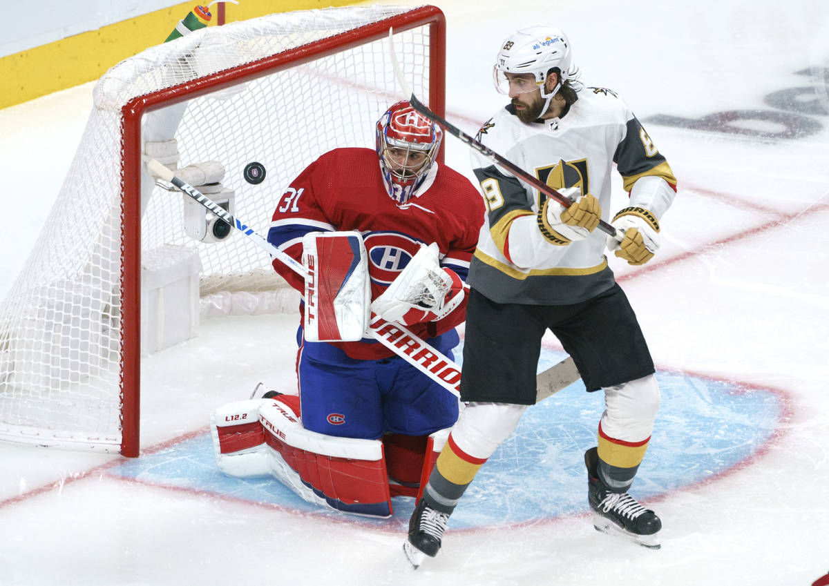 Montreal Canadiens goaltender Carey Price stops a shot as Vegas Golden Knights' Alex Tuch looks ...
