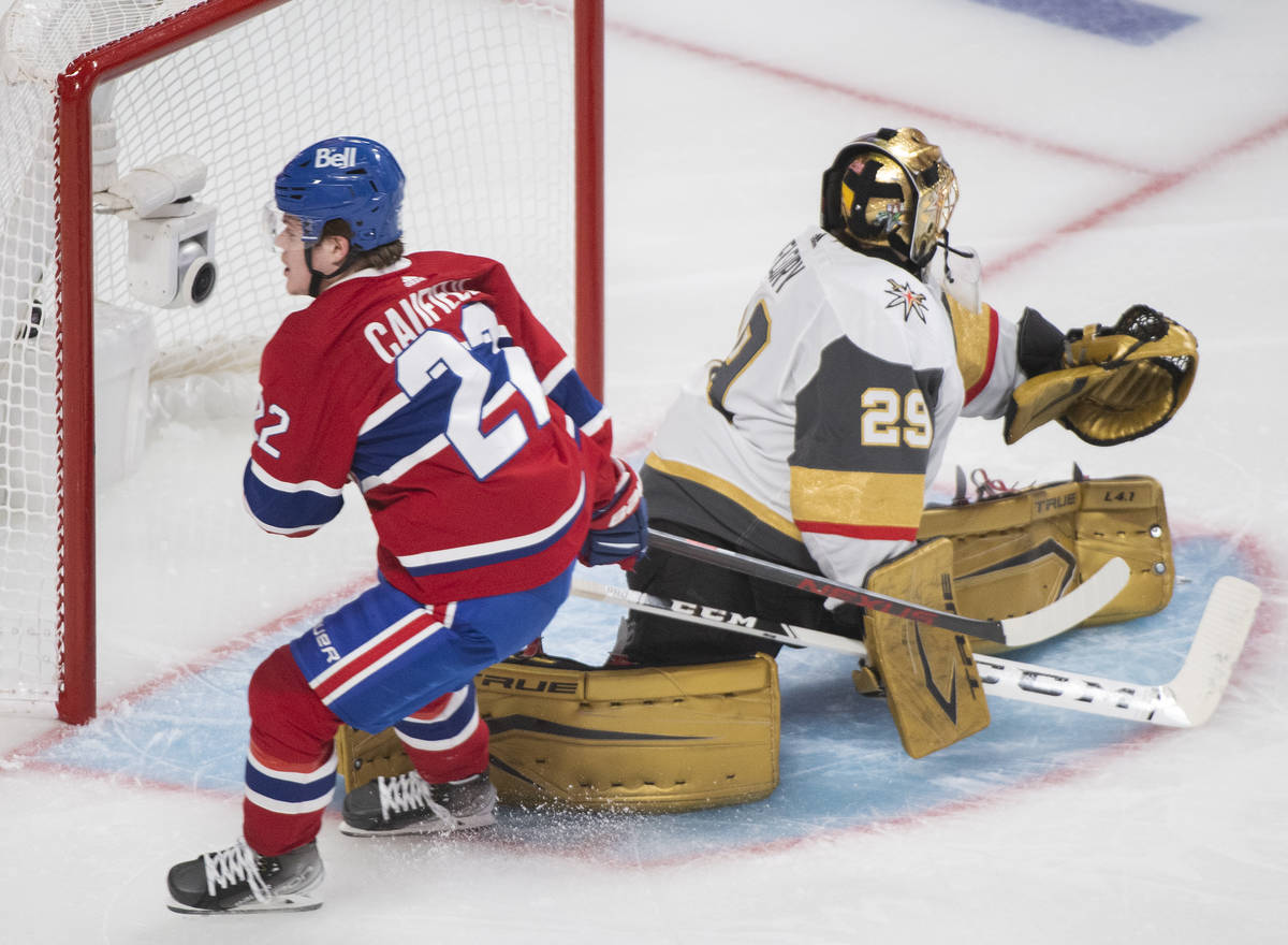 Montreal Canadiens' Cole Caufield scores against Vegas Golden Knights goaltender Marc-Andre Fle ...