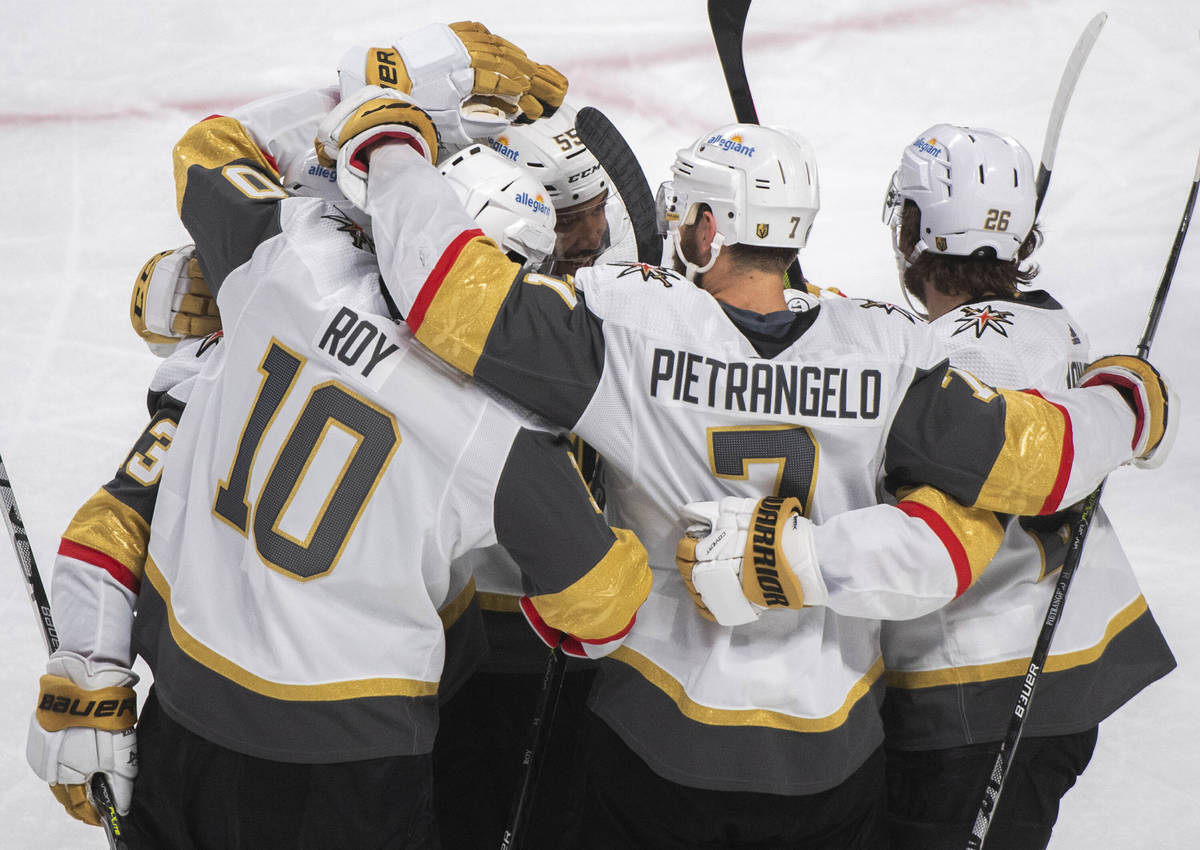 Vegas Golden Knights' Nicolas Roy (10) celebrates with teammates after scoring against the Mont ...