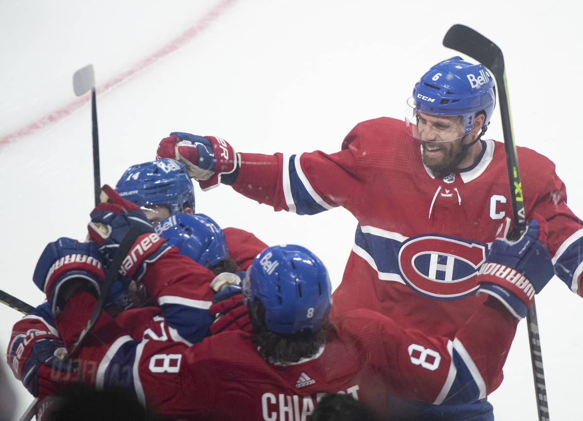 Montreal Canadiens celebrate a goal by Cole Caufield against the against Vegas Golden Knights d ...