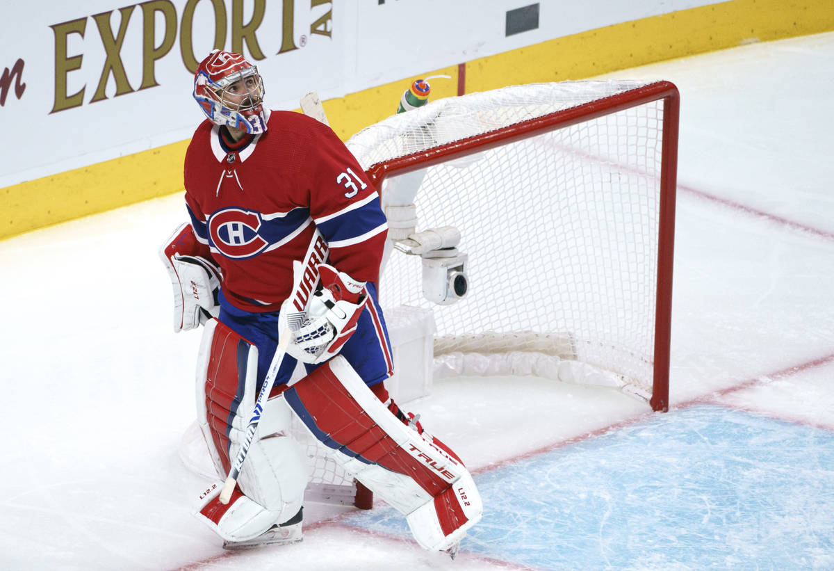 Montreal Canadiens goaltender Carey Price looks up at the replay following a goal by Vegas Gold ...