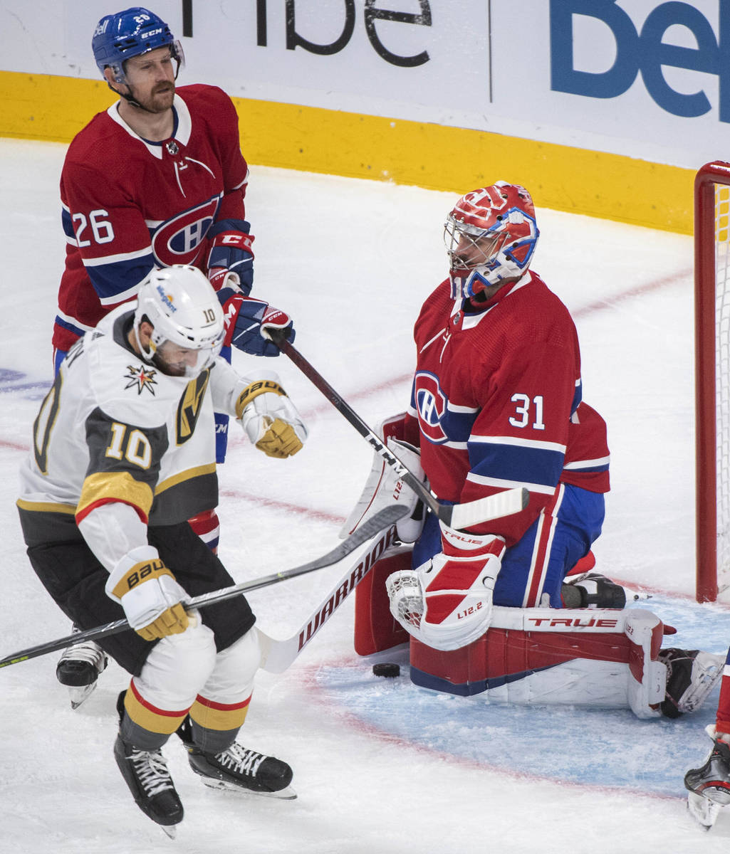 Vegas Golden Knights' Nicolas Roy (10) reacts after scoring against Montreal Canadiens goaltend ...