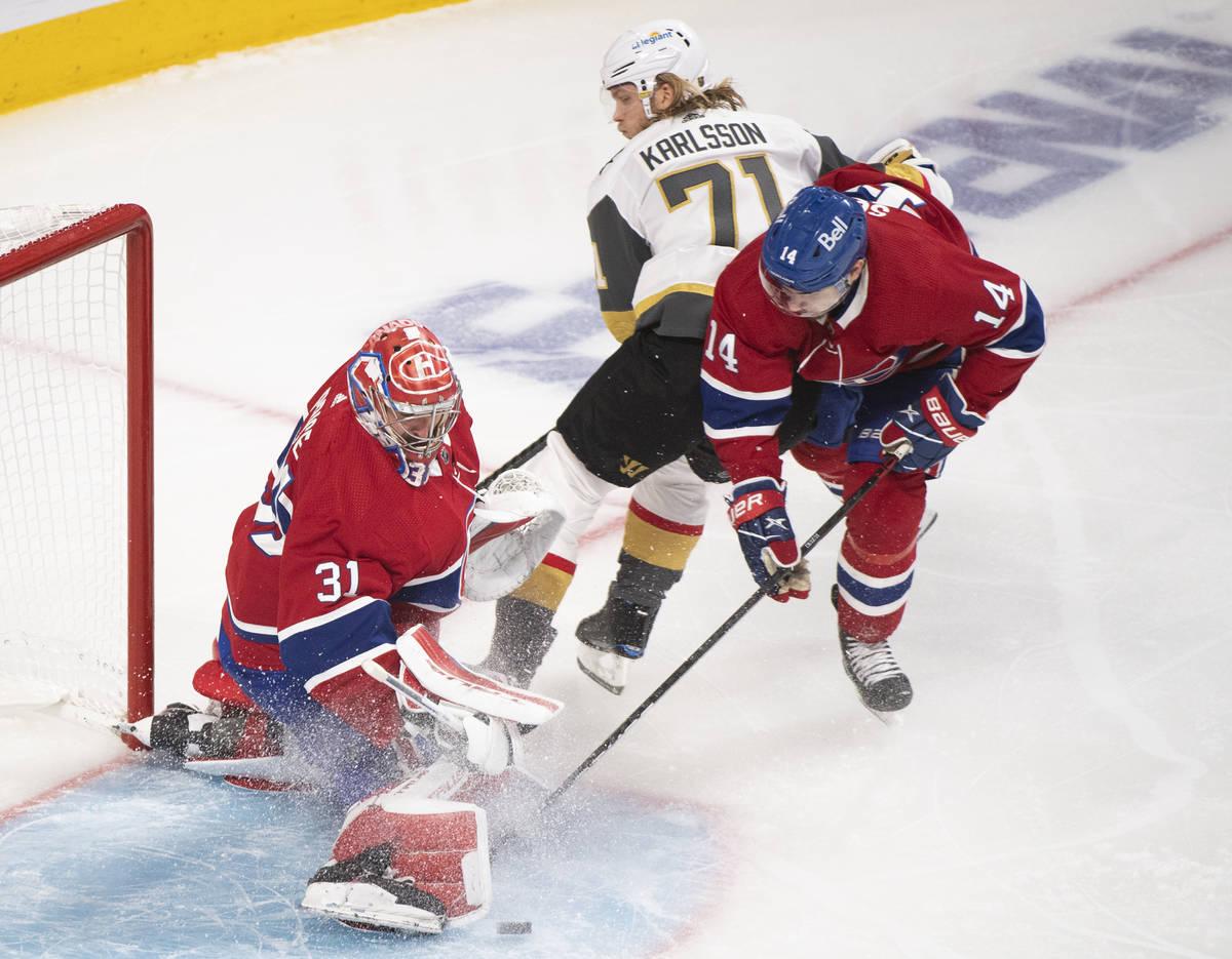 Montreal Canadiens goaltender Carey Price stops Vegas Golden Knights' William Karlsson (71) as ...