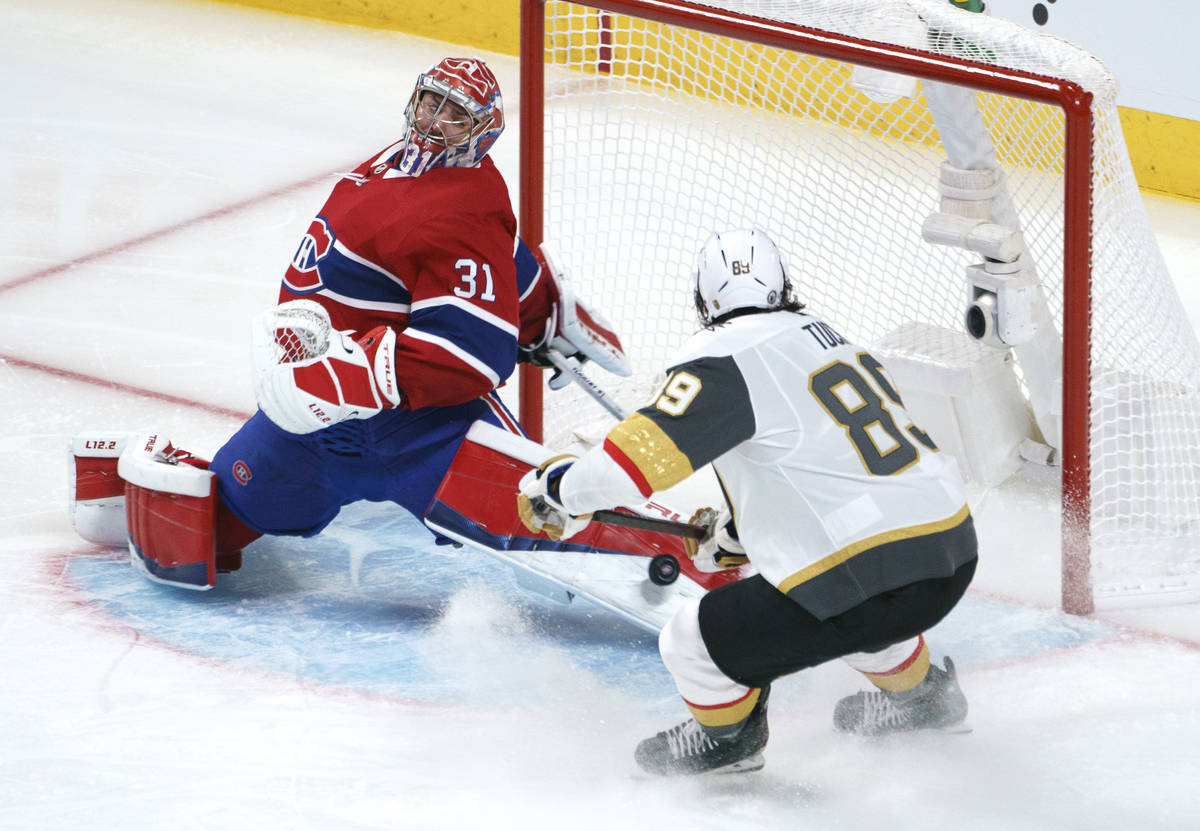 Montreal Canadiens goaltender Carey Price makes a save on Vegas Golden Knights' Alex Tuch durin ...