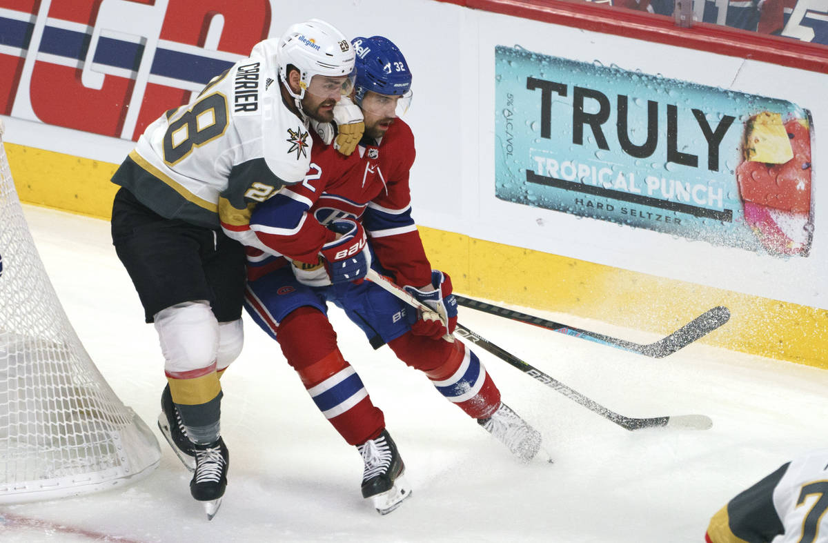 Vegas Golden Knights' William Carrier hangs on to Montreal Canadiens' Erik Gustafsson during th ...