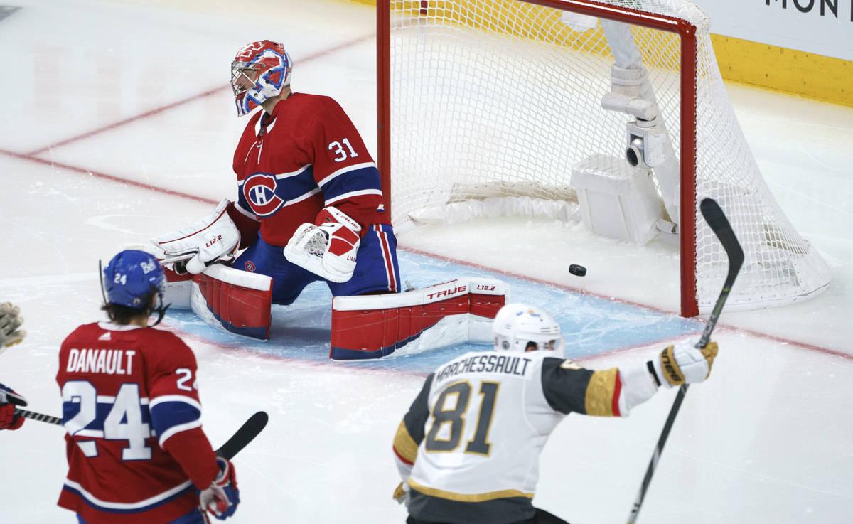 Vegas Golden Knights' Jonathan Marchessault celebrates a goal by Alex Pietrangelo on Montreal C ...