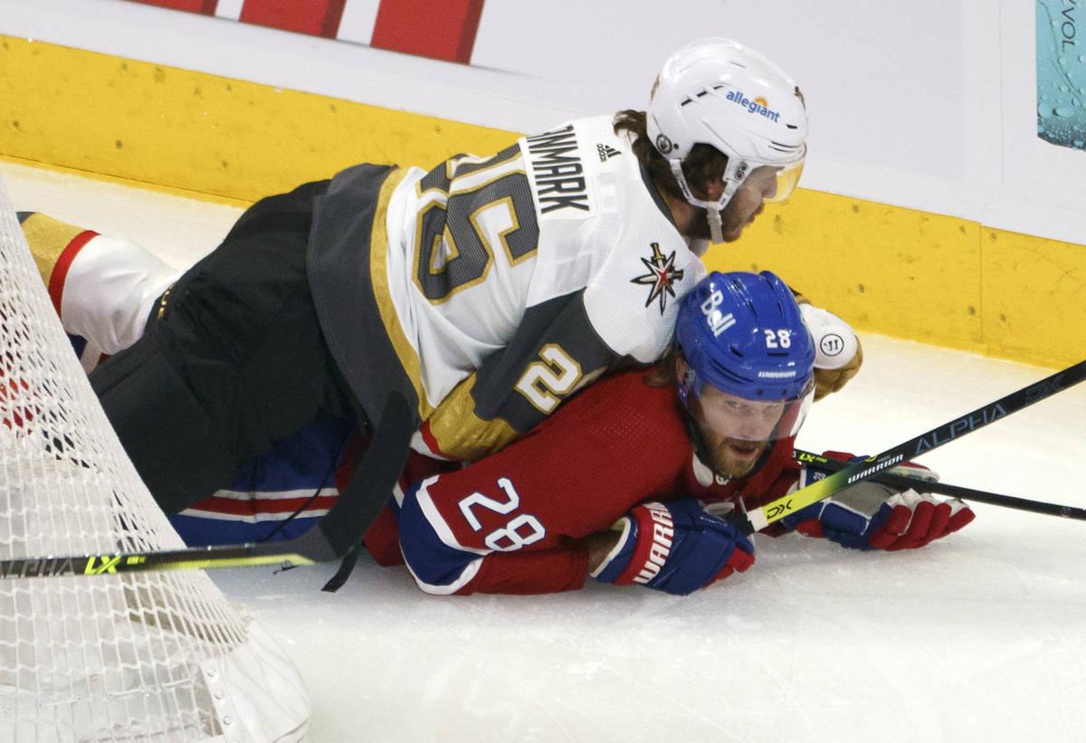 Vegas Golden Knights' Mattias Janmark falls onto Montreal Canadiens' Jon Merrill during the fir ...