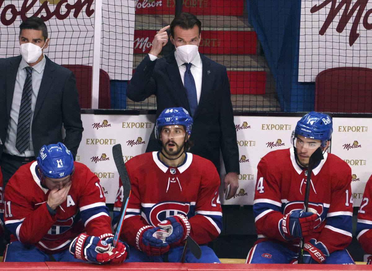 Montreal Canadiens substitute coach Luke Richardson stands behind the team bench during the fir ...