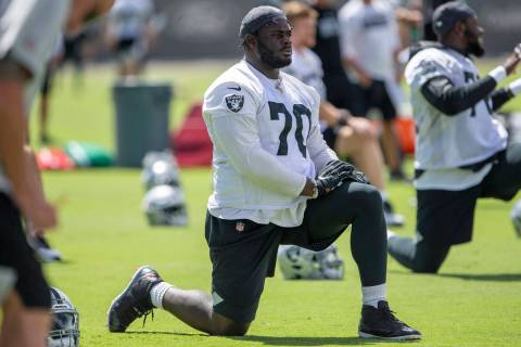 Raiders offensive tackle Alex Leatherwood (70) stretches during the teamÕs NFL football pr ...