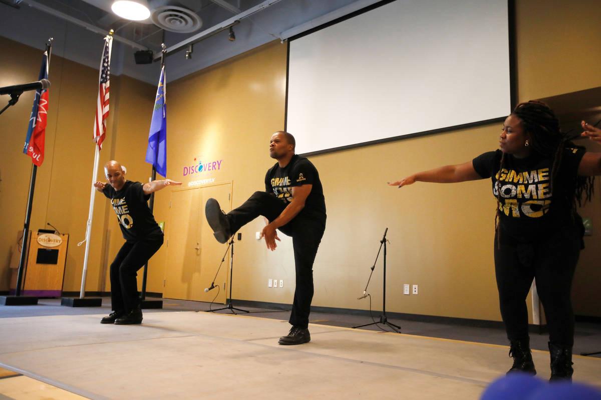 Members of Molodi, a performance ensemble, Khalid Freeman, from left, Director Jason Nious, and ...