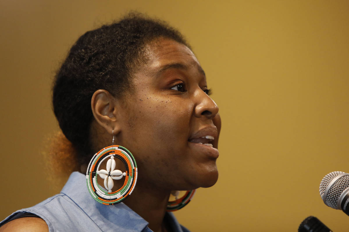 Former Poet Laureate for Clark County Vogue Robinson reads a poem during a Juneteenth celebrati ...