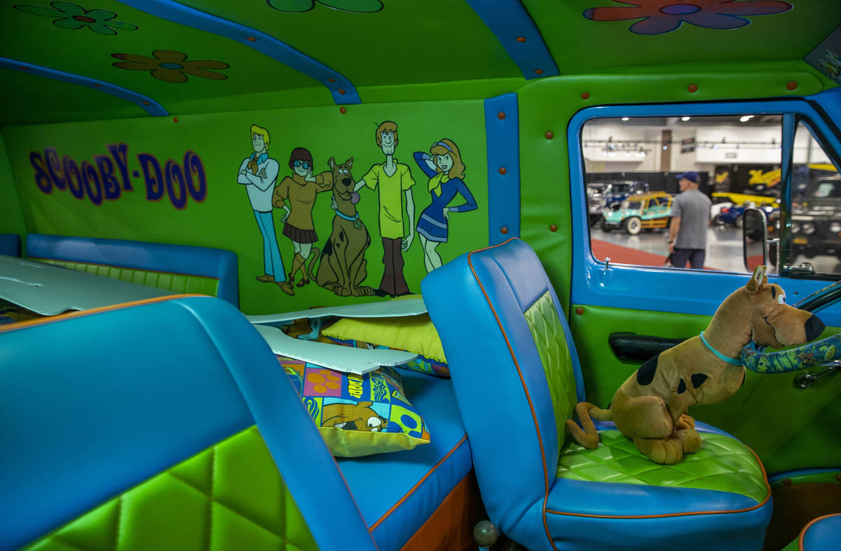 Scooby-Doo sits behind the wheel of a 1968 Ford Econoline ÒMystery MachineÓ van recre ...