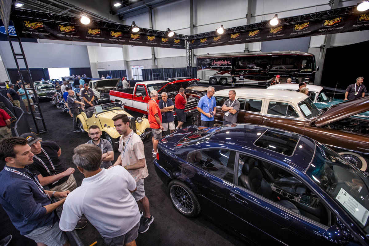 Invited guests gather in the cue area as cars up for bid will soon be sold during the Barrett-J ...