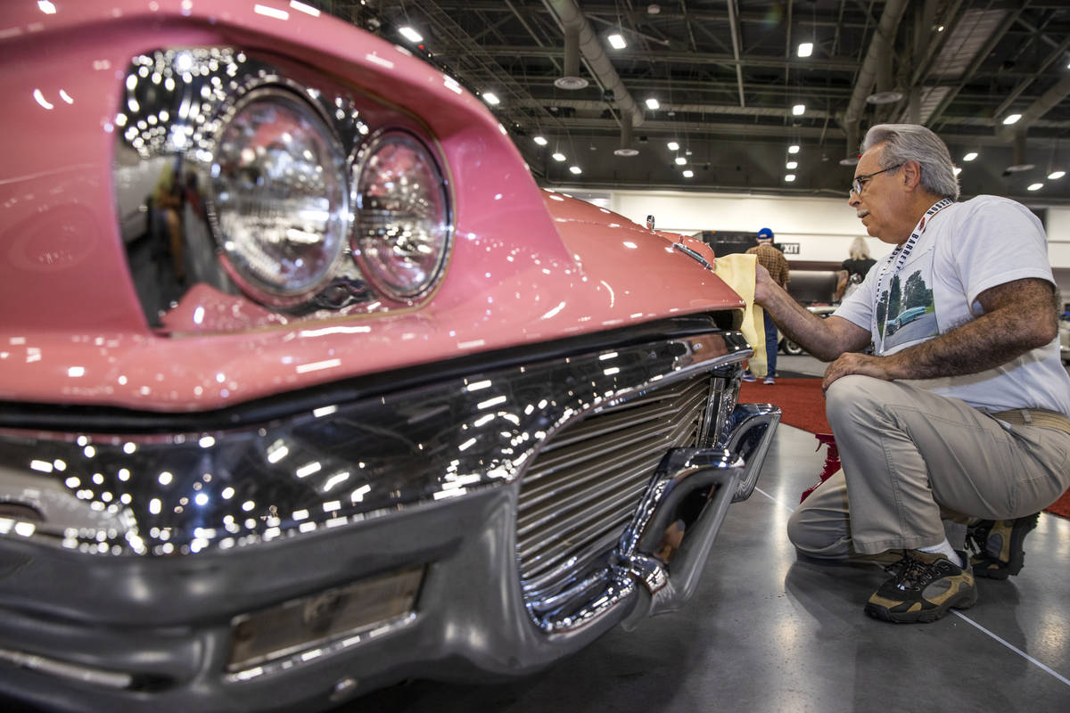 New owner Steve Maconi of Wilmington, Delaware, polishes up his 1959 Ford Thunderbird Convertib ...