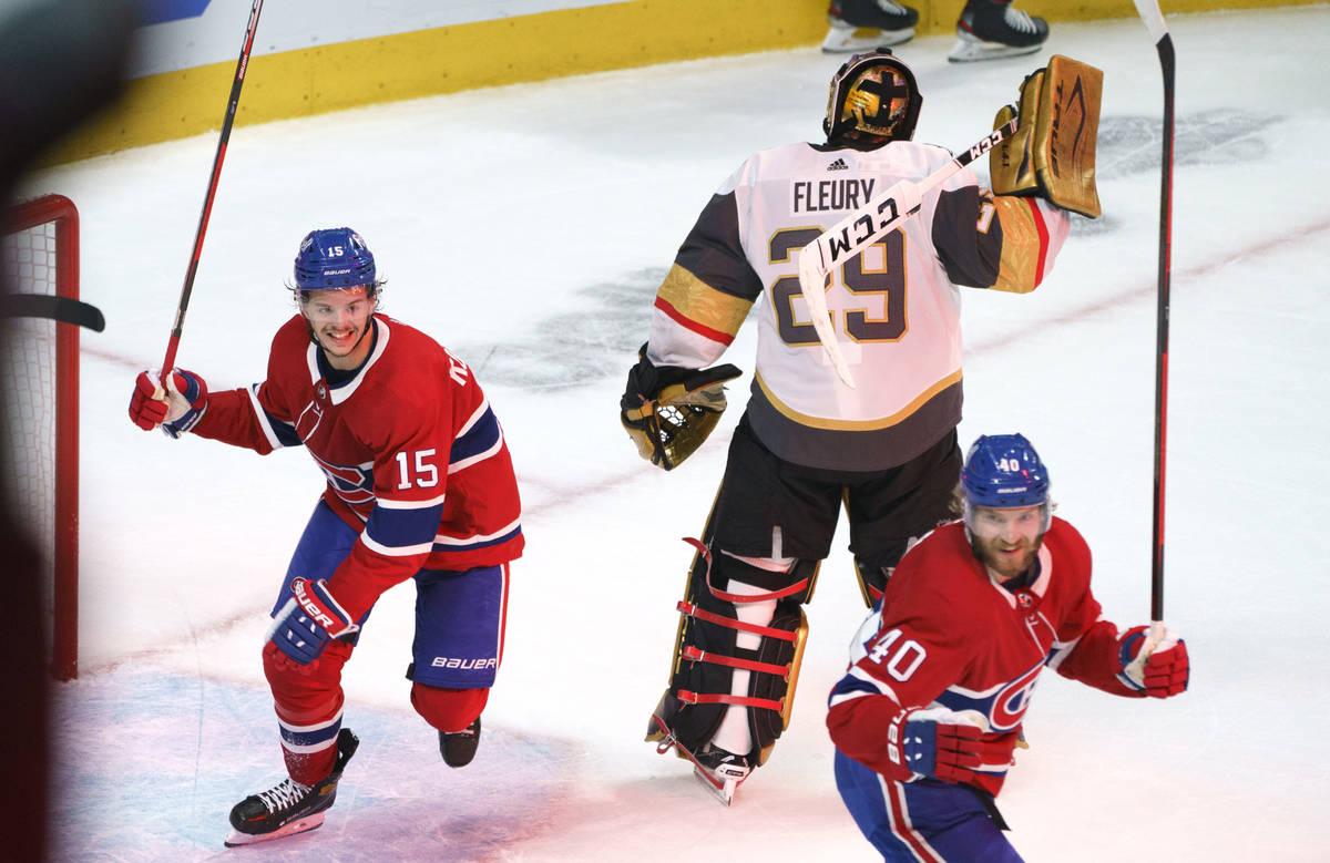 Montreal Canadiens' Jesperi Kotkaniemi, left, and Joel Armia celebrate a goal by Josh Anderson ...