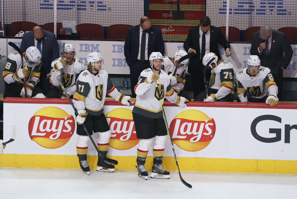 Vegas Golden Knights' William Karlsson, left, and Brayden McNabb watch the Montreal Canadiens c ...
