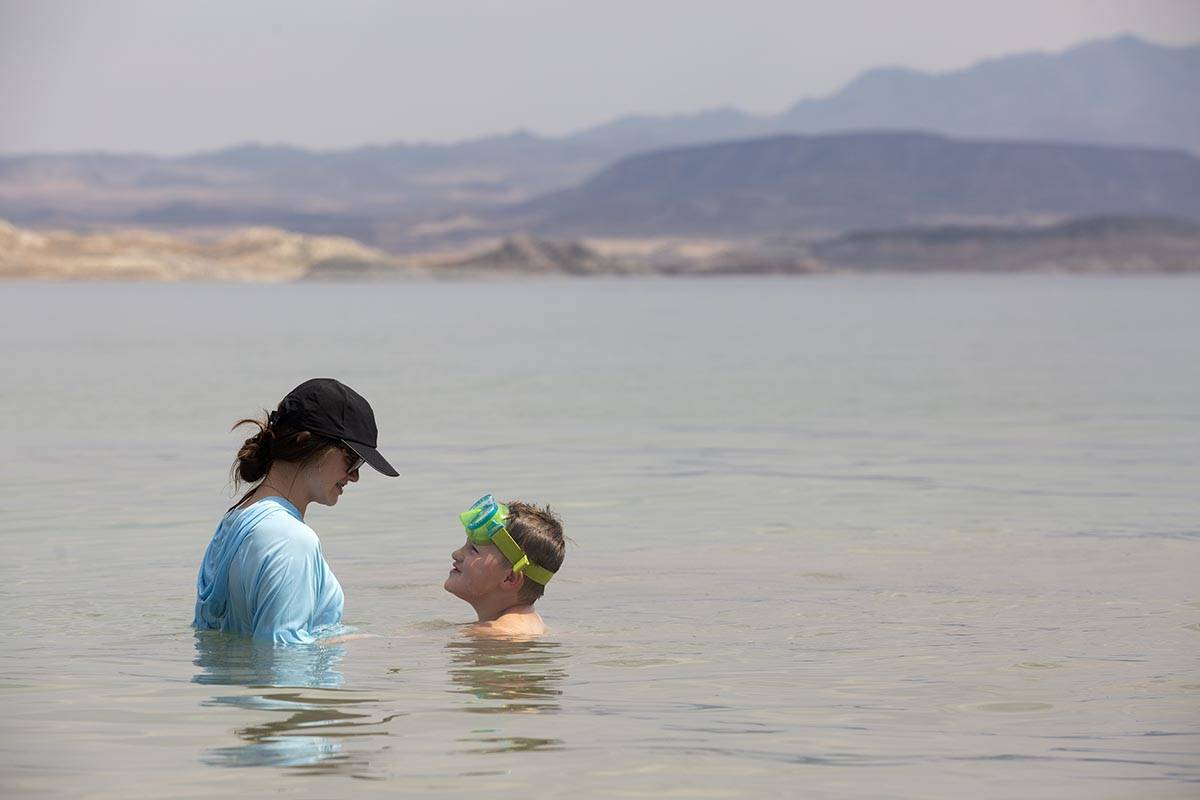 Emma Pratt, 14, and her brother Noah Pratt, 5, of Mississippi, cool off in the water along Boul ...