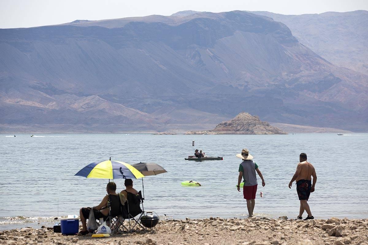 People sun themselves, jet ski, kayak and swim along Boulder Beach at Lake Mead on Saturday, Ju ...