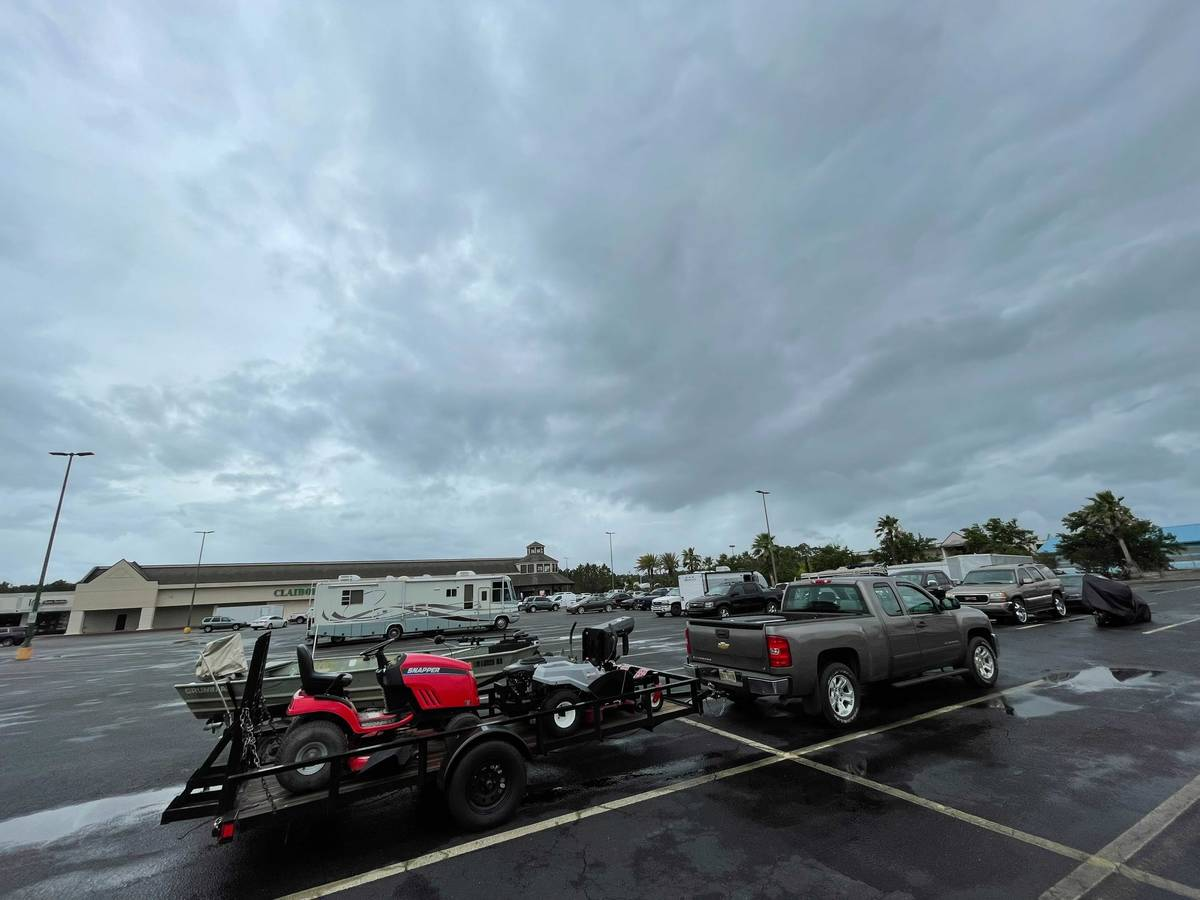 Residents in low-lying areas of Hancock County move their vehicles, lawn mowers, ATVs and boats ...