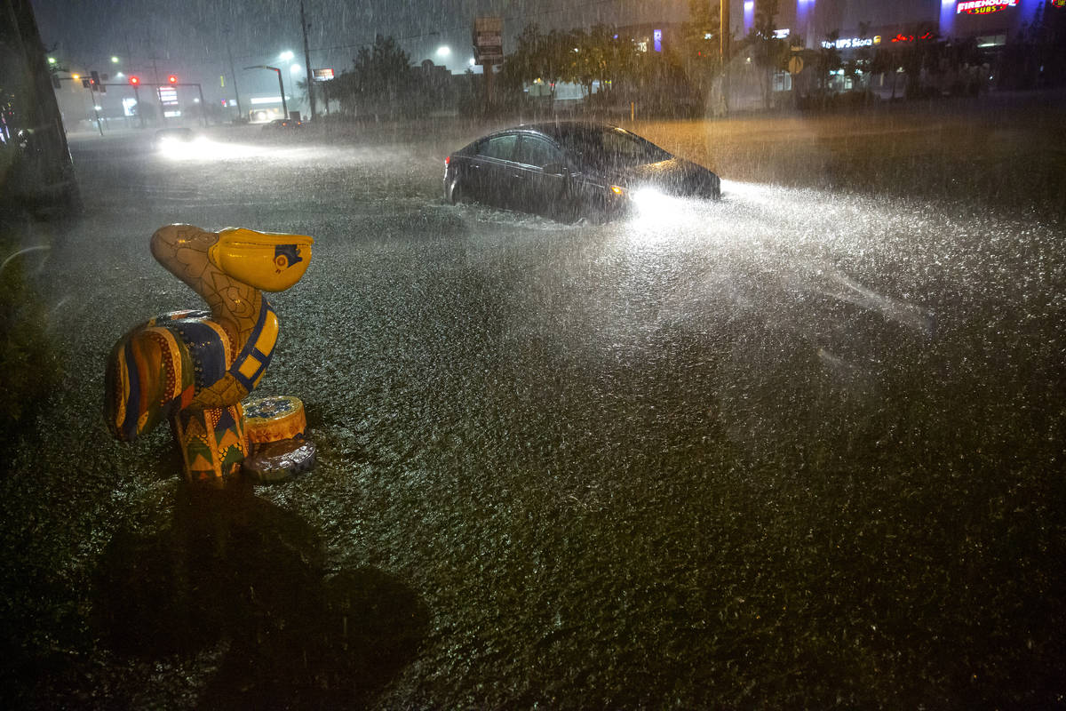 Motorists navigate a flooded Gause Boulevard in Slidell, La., late Friday, June 18, 2021, as a ...