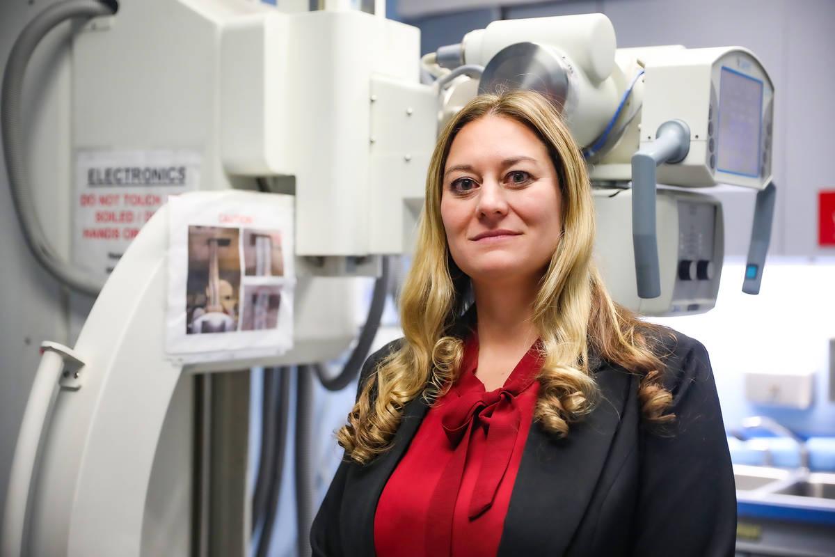 Clark County Coroner Melanie Rouse next to the X-ray machine at the Clark County Coroner Office ...