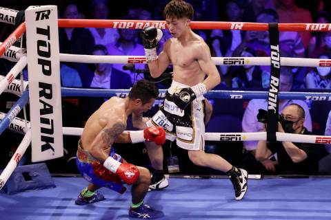 Naoya Inoue connects a body punch to knockout Michael Dasmarinas in the third round of the WBA ...