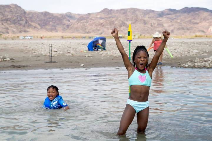 Jaden Richardson, 6, left, and Jaki Walker, 8, both of North Las Vegas, cheer as Walker made he ...