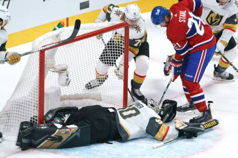 Montreal Canadiens' Eric Staal tries to poke the puck away from Vegas Golden Knights goaltender ...